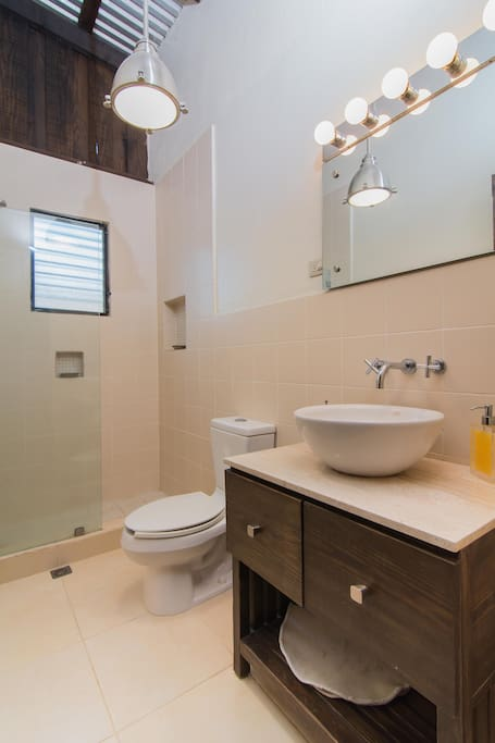 Modern adjacent bathroom (may be shared with one other room)