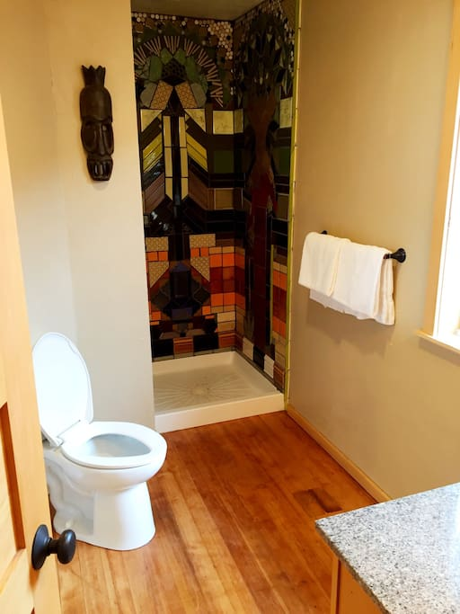 Hardwood floors inside of a spacious bathroom