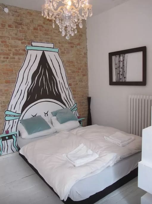 Cosy double bed with painted canopy