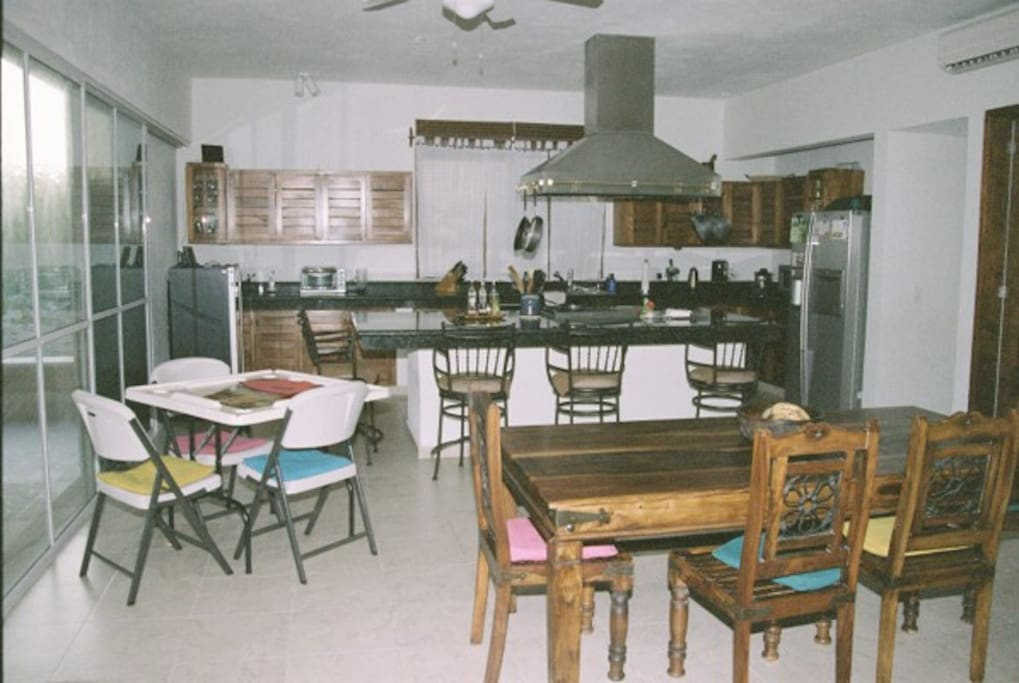 Large spacious dining kitchen area with professional Viking Stove.