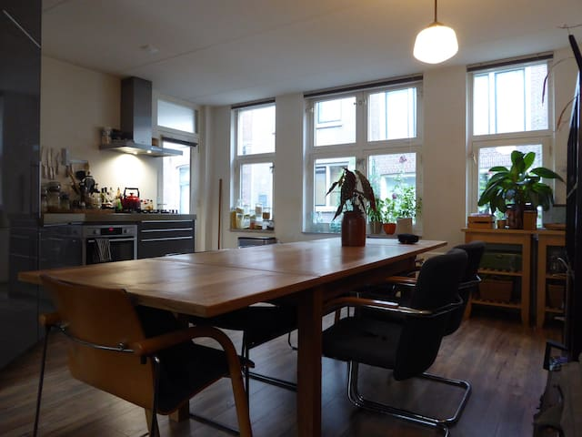 Relaxed and light main-floor apartment with garden
