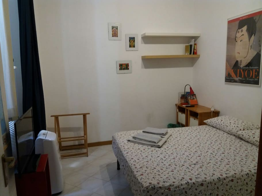 Your double bed with towels+tv+air conditioning