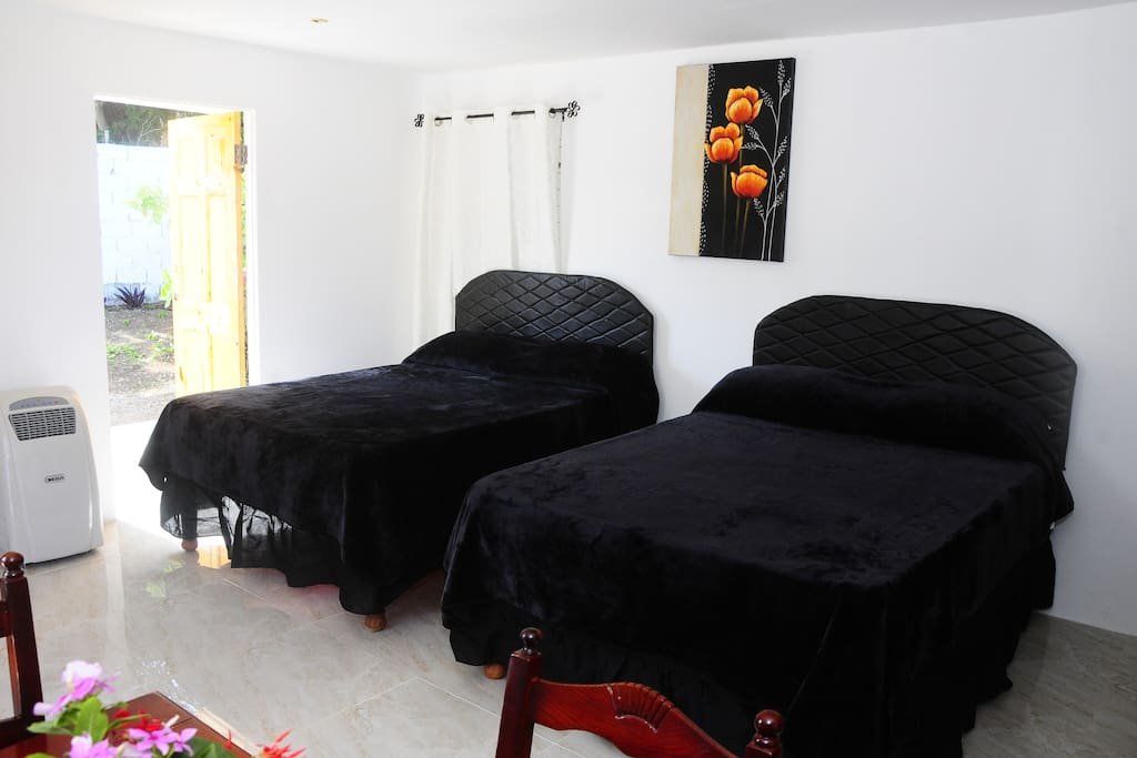 The Cottage is one large room with 2 double beds, TV, sound system, dinning table, Wardrobe, Personal Kitchen also bathroom, air conditioning also Cable TV along with Wi Fi.  The kitchen is fully loaded with fridge freezer, cooker, toaster, micro wave   Bathroom has hot water shower, toilet and washbasin