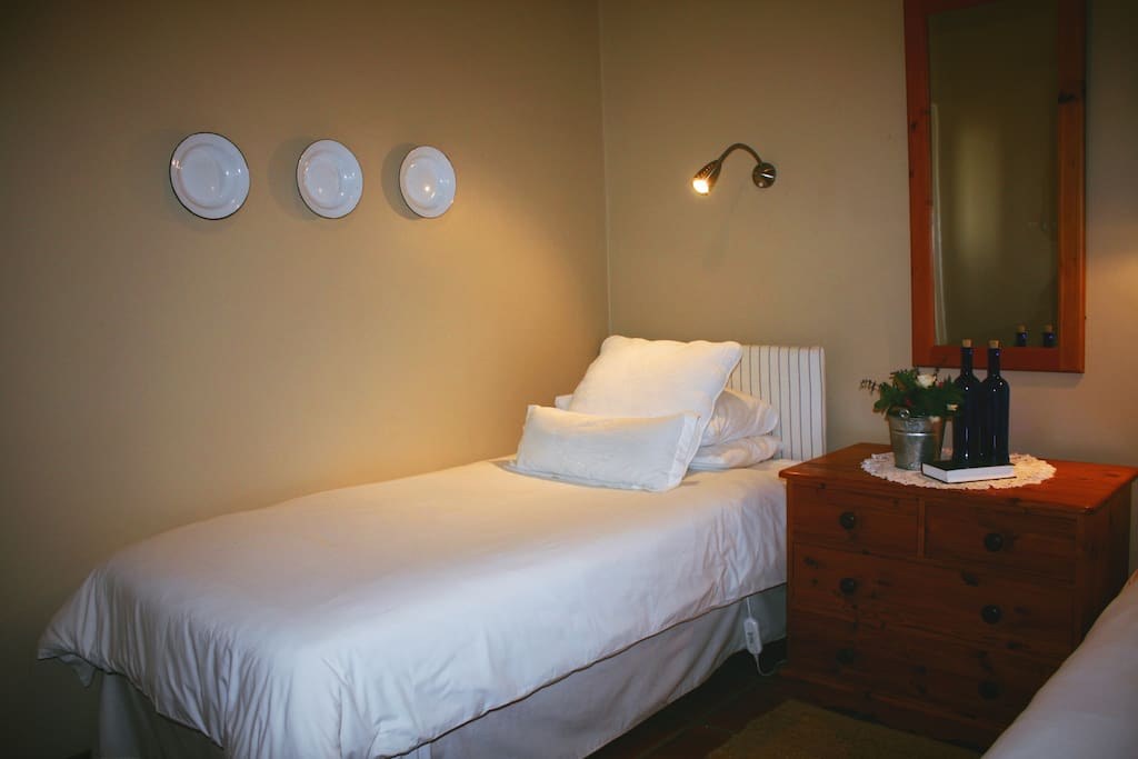 Bedroom of the Plumbago Suite