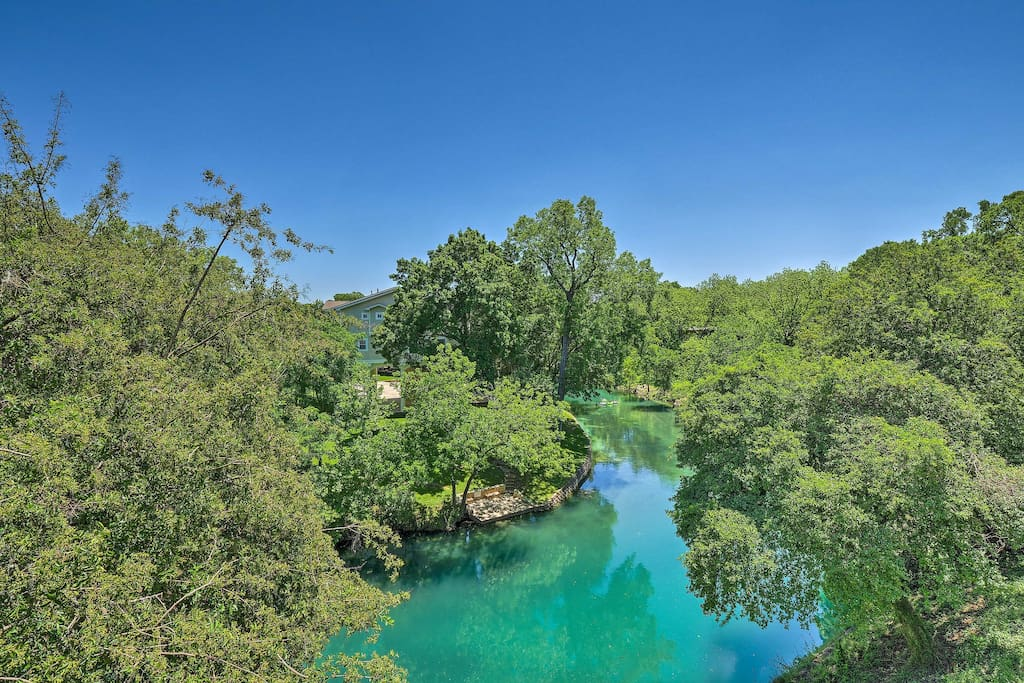 This home is located right on the Comal River!