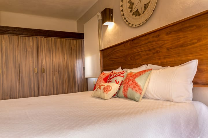 Ultra comfortable mattress and cotton linens in spacious master bedroom with king size bed and master bathroom