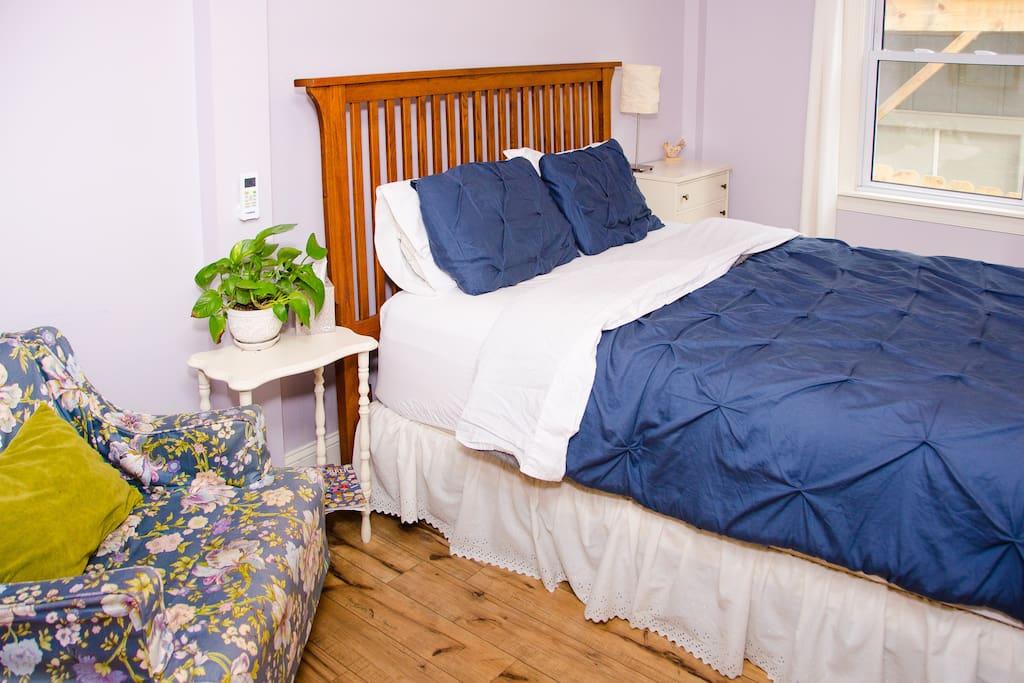 1st bedroom in suite has a super cozy, pillow-top queen size bed.