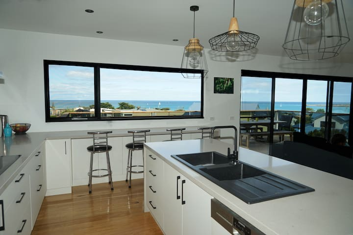 Kitchen with walk in pantry and wonderful views while you cook.