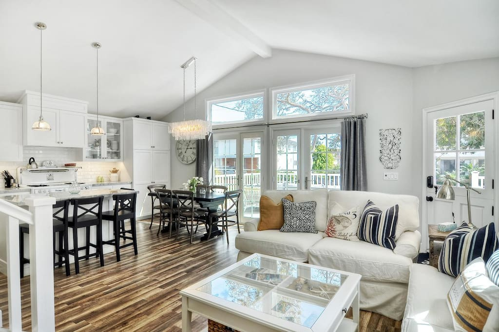 Great room at with living, dining, kitchen, and doors onto the deck.