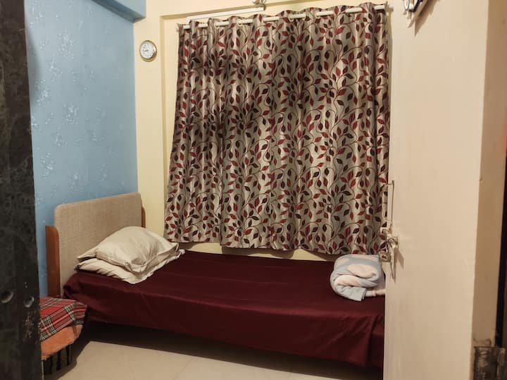 Simple non AC private small and clean room at Juhu