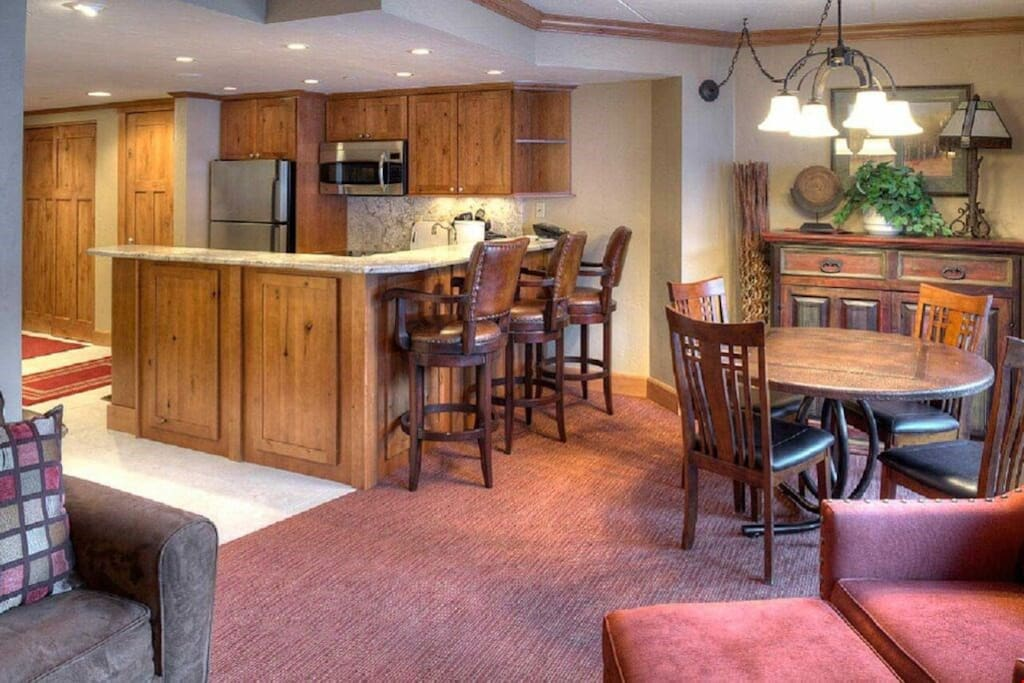 Entertain and dine together at the dining table with chairs.
