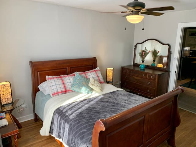 Main bedroom. Light switch located to the right of sleigh bed. Tap touch light to the right of door jam for quick light.