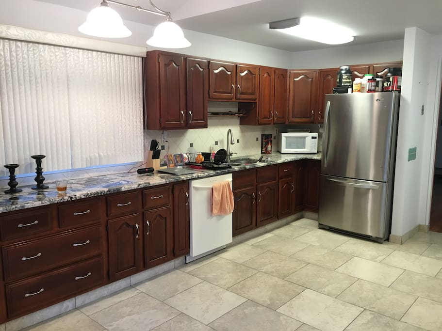 Kitchen- microwave, refrigerator, dishwasher, Keurig, pots/pans/utensils