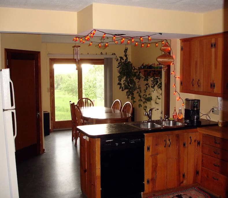 Fully equipped kitchen with modern appliances. Large dining area with great view.
