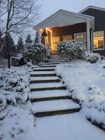 front of house in the snow