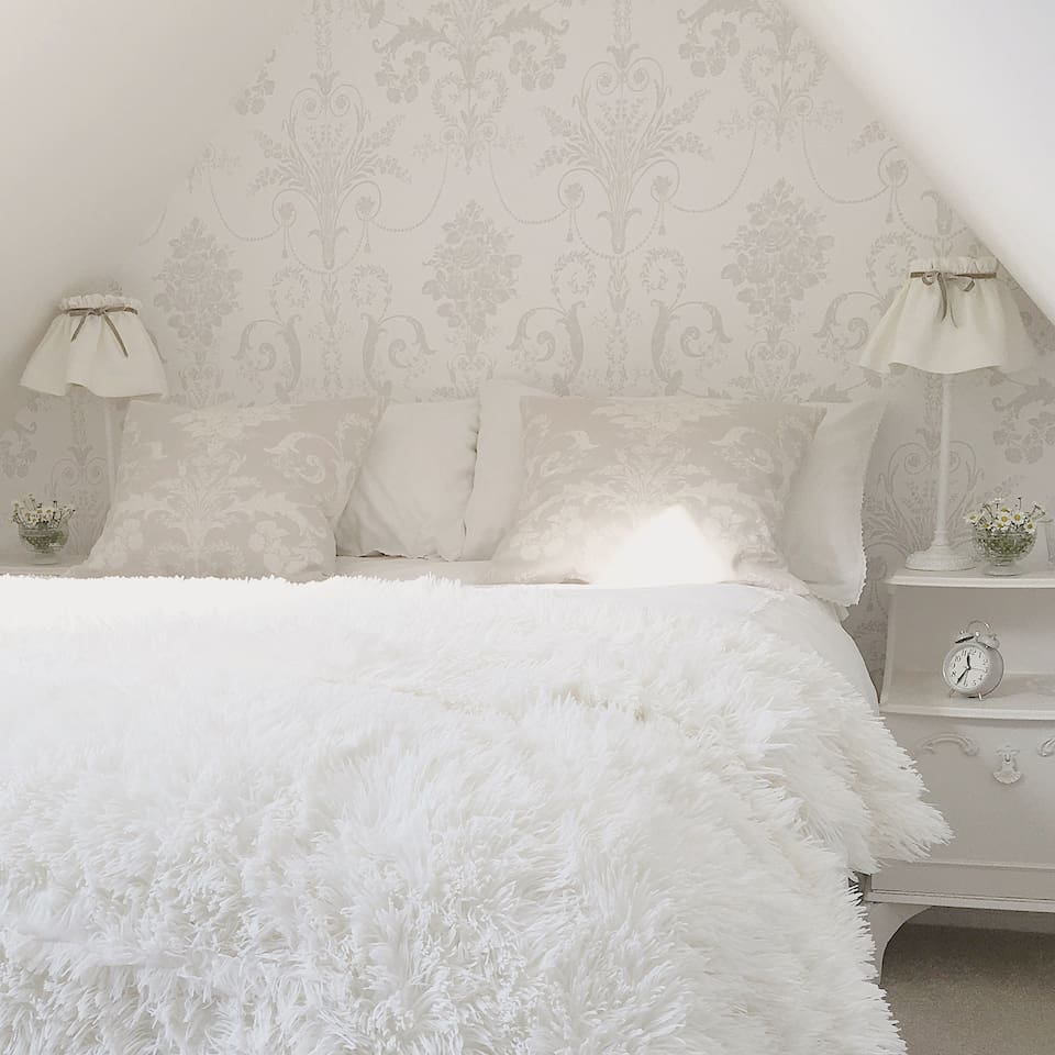 Guest bedroom situated at the top of the house with beautiful views over the formal grounds