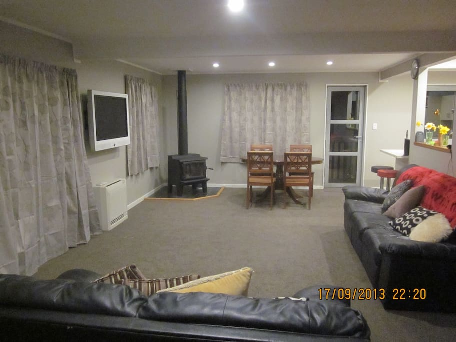 Main house.  Large living/TV room, with views over lake Wakatipu to Queenstown Hill.