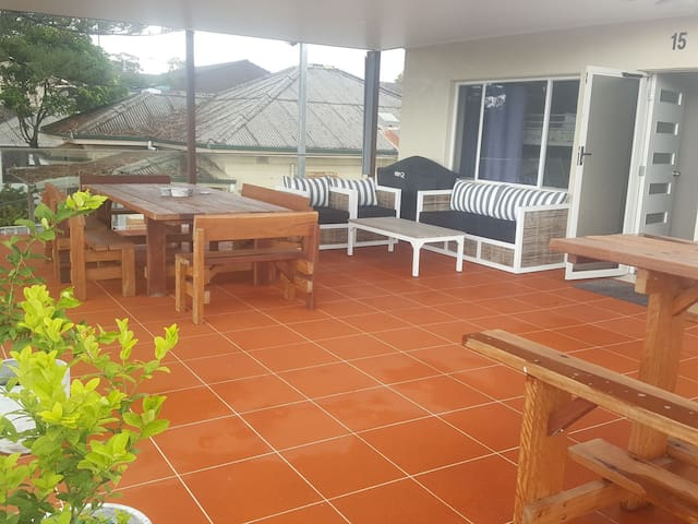 private 65m2 deck with outdoor lounge, table, Webber BBQ and bar