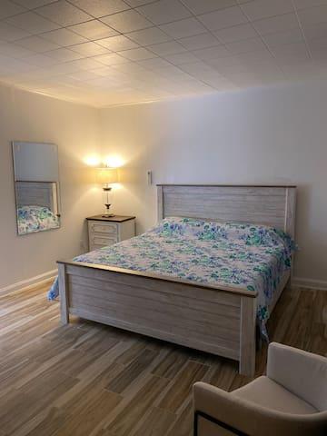 Comfortable bedroom with a king size bed and orthopedic mattress