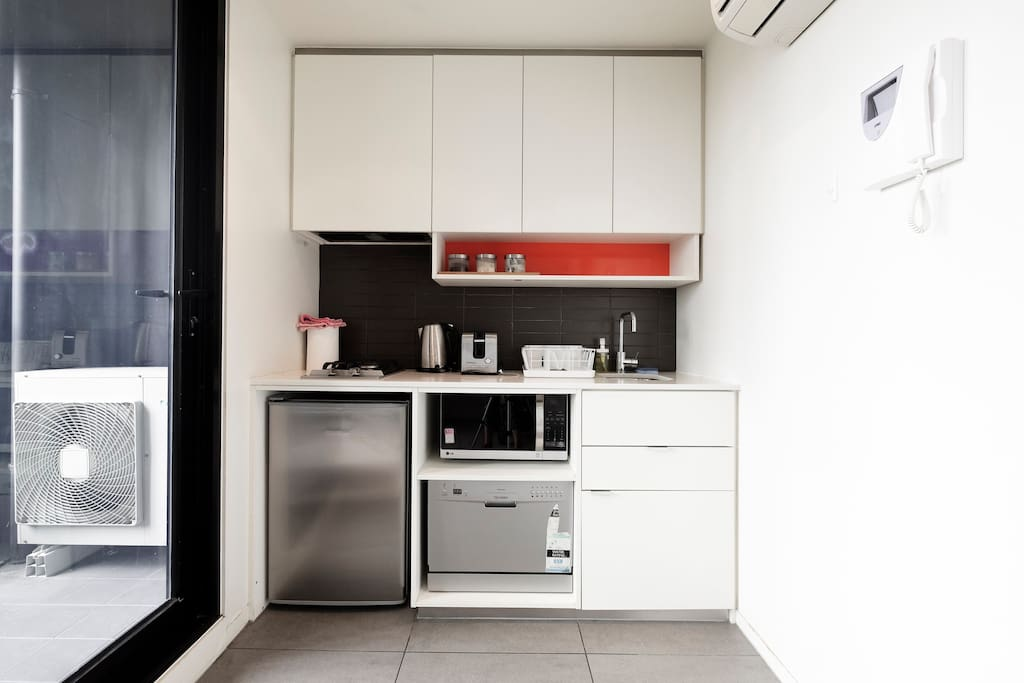Modern appliances and cooking utensils in the kitchen.