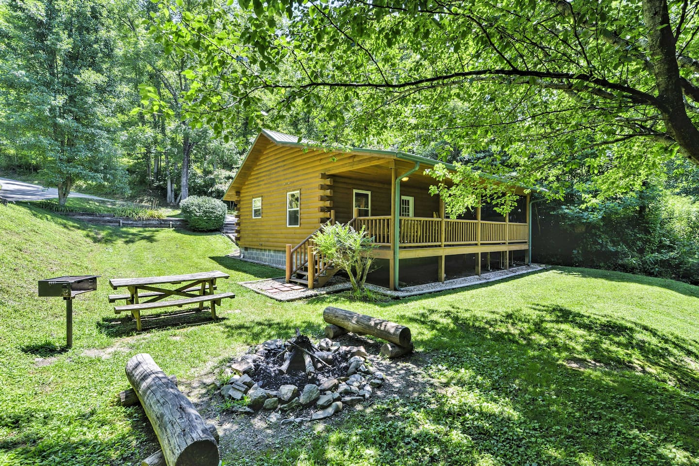 Look forward to a memorable stay at 'Fox Creek Hillside Cabin,' a charming 2-bedroom, 1-bath vacation rental cabin in Bryson City.