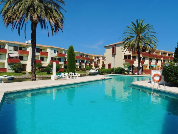 2 bedroom apartment in residential area overlooking the canal and communal pool.