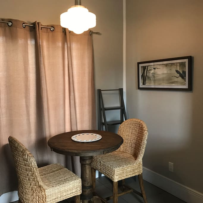 Small dining nook off of the kitchen for a morning cup of coffee or for entertaining while cooking.
