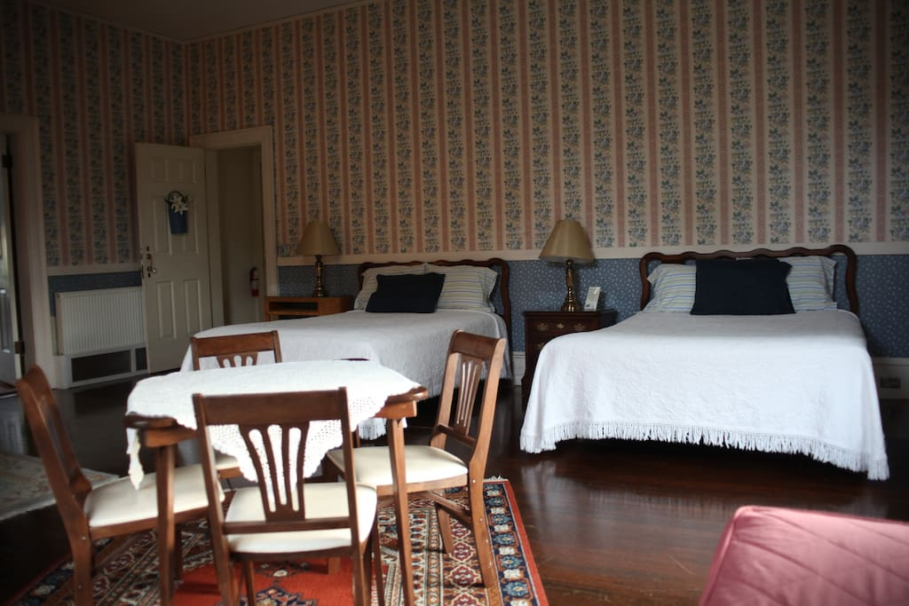 Two queen-sized beds, and a twin day bed, with room to play cards.