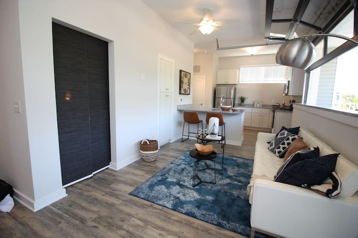 This cozy space is open and inviting! Bring the outdoors in by opening the garage door.