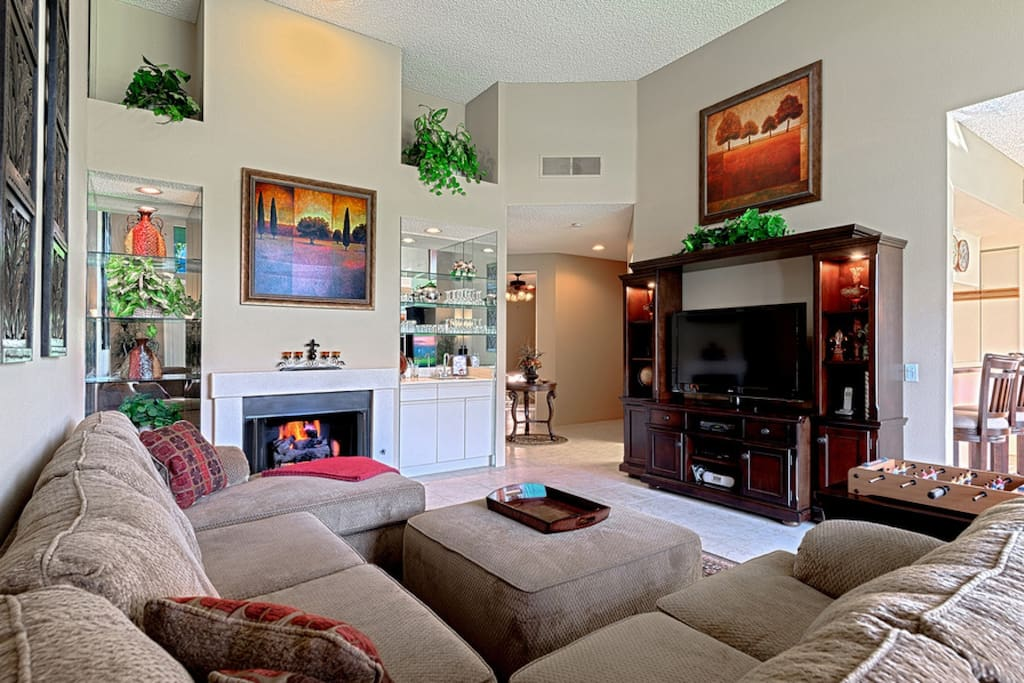 """Cozy up to the fire on the plush couch and enjoy the 42"""" HDTV"""