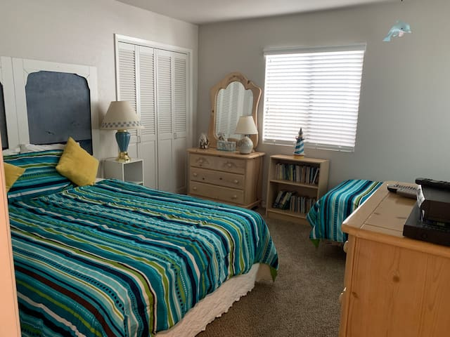 """""""Back Porch Room"""" with one queen size bed and one twin"""