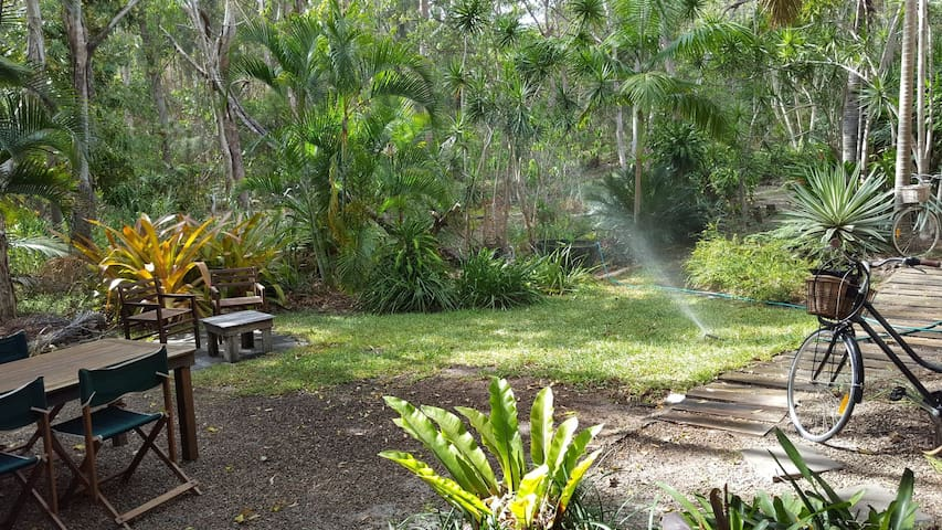 Tropical Oasis Backing on to Bush and Beach
