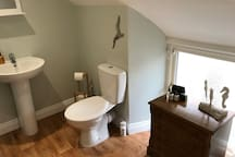 The Bankhouse Mews - Bathroom consists of bath with overhead shower, wc and sink with complimentary luxury toiletries