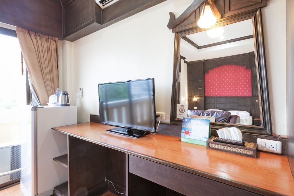 Flat Screen TV and Dresser/Work Space