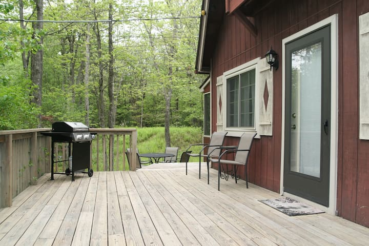Upper tier of the outdoor deck, complete with BBQ and extra outdoor seating.
