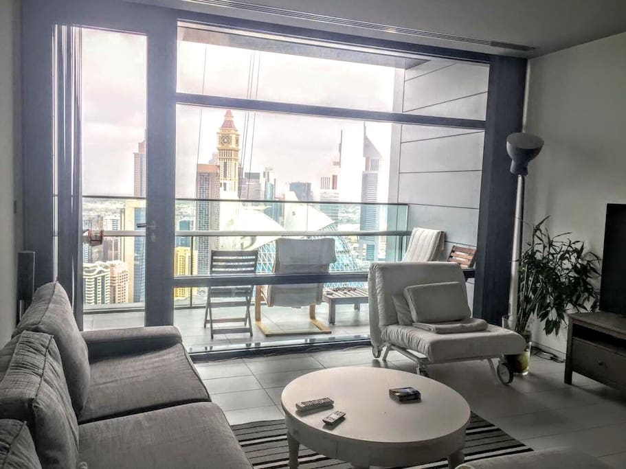 Comfortable living room with HUGE window and amazing view
