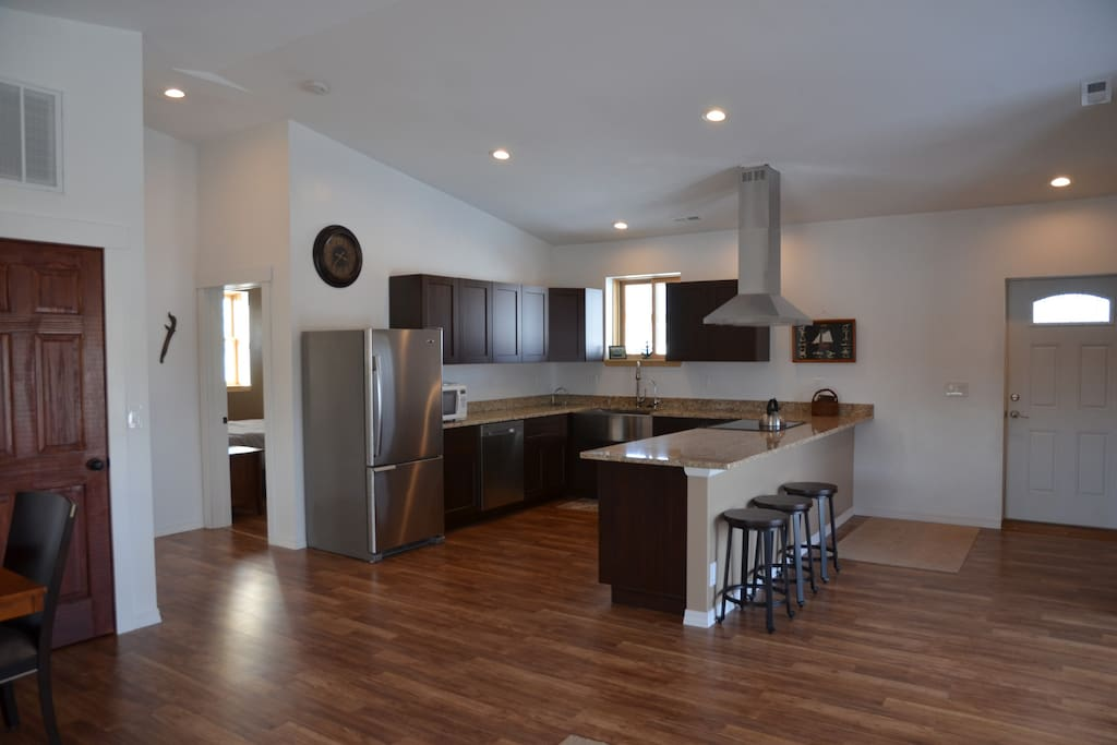 Full gourmet kitchen with cook ware and dishes.