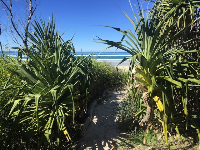 Direct private  beach access from property  via pandanus  path.