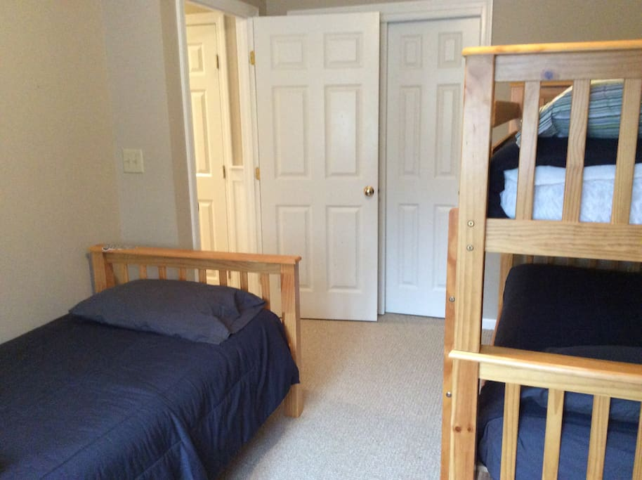 1st floor bedroom with 3 twin beds