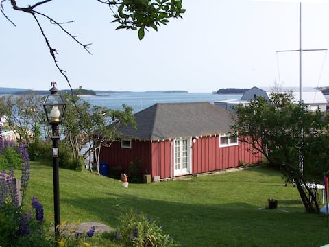Cozy cabin w/ kayaks & dock only feet from harbor.