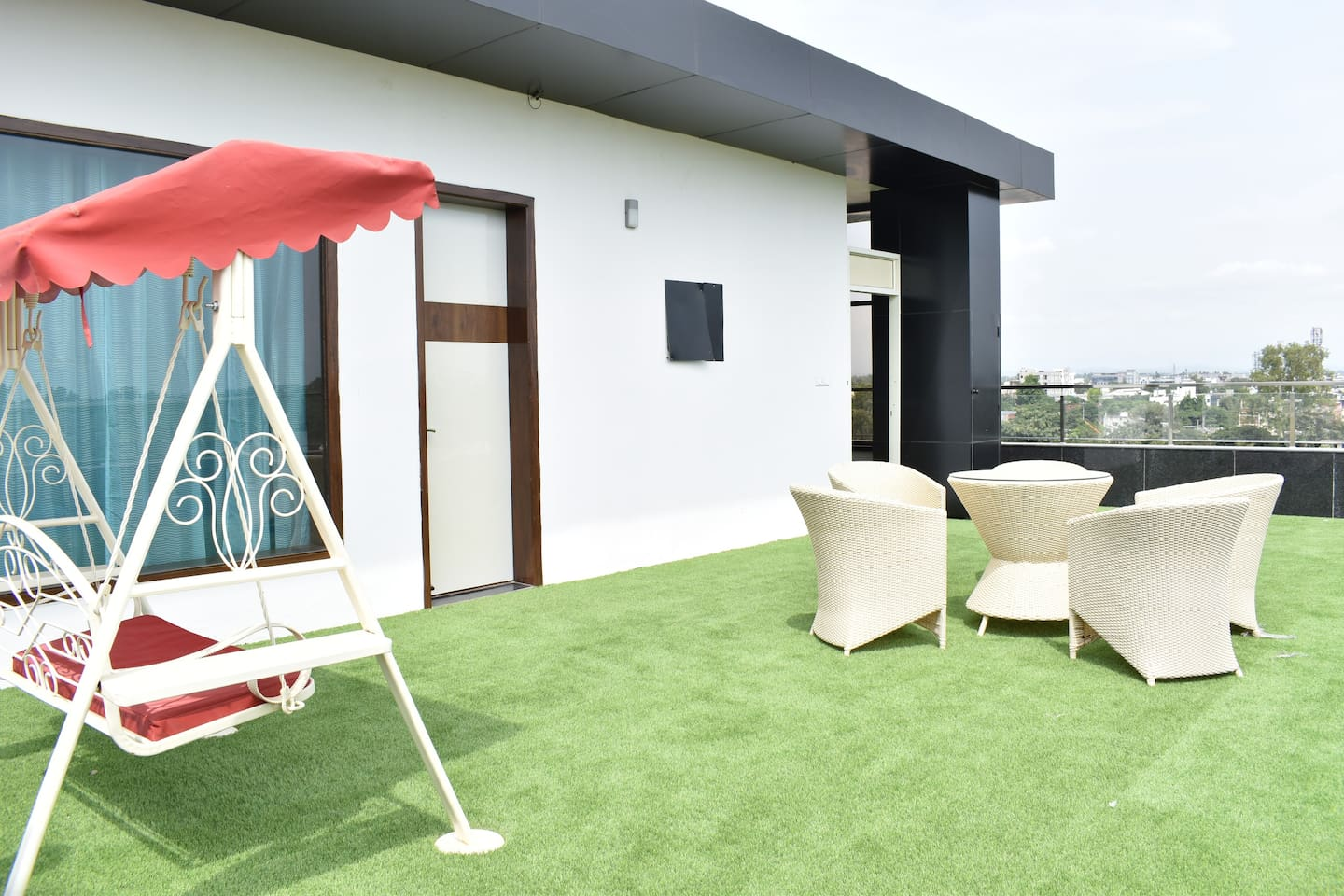 Front side lawn with sitting area and a Swing. It gives great experience in the morning and evening hours and you can see the hills as well when the weather is clear.