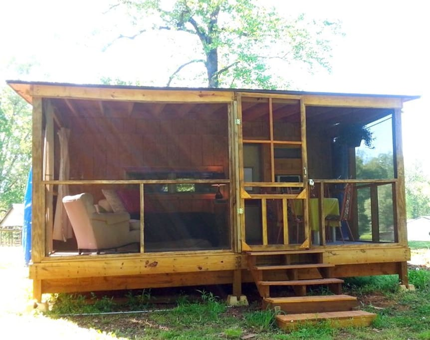 Screened porch has views of woods and sometimes cavorting goats!