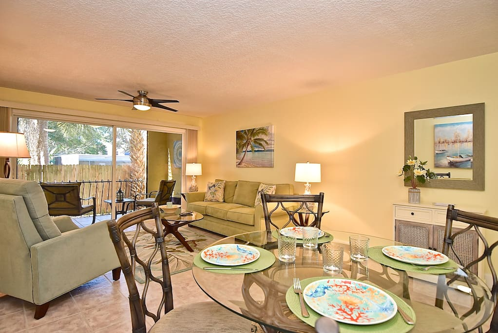 Open concept design with private screened-in lanai beyond sliding glass doors.