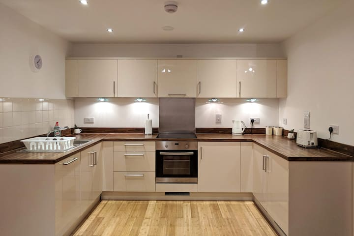 Spacious and fully-fitted kitchen with modern appliances