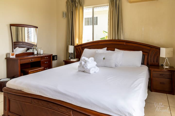 A king size bed in one of the upper level bedrooms.
