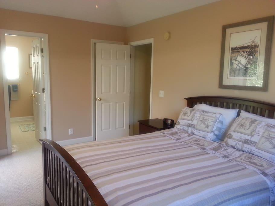 Master bedroom with master bath, walk in closet.