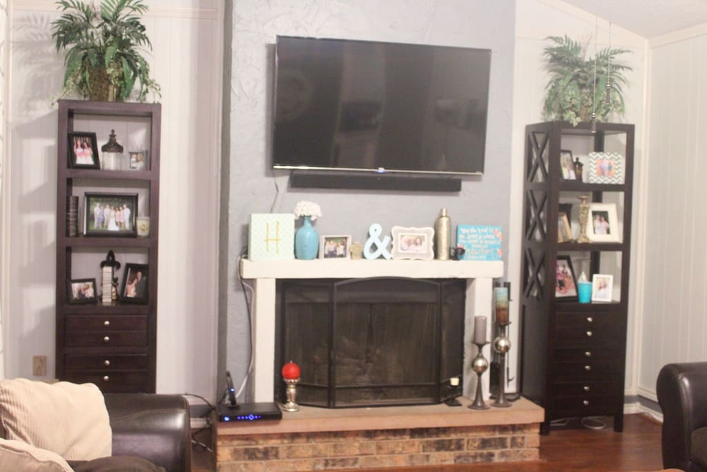 Mounted big screen Smart Tv with sound bar for surround sound feel with cable, netflix, and hulu! Gas fireplace