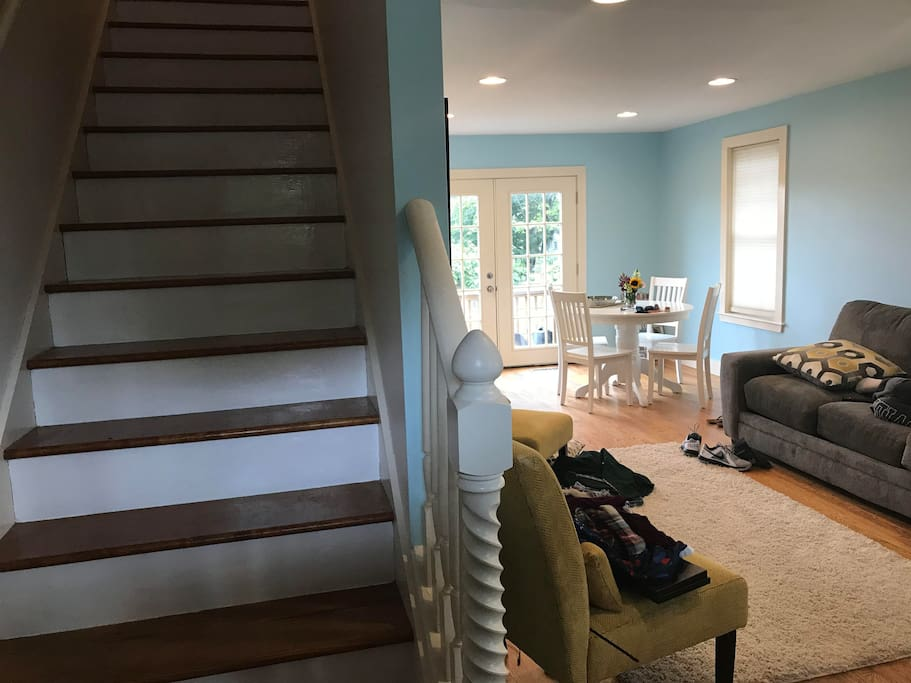 View from the front door (stairs, living, and dining)