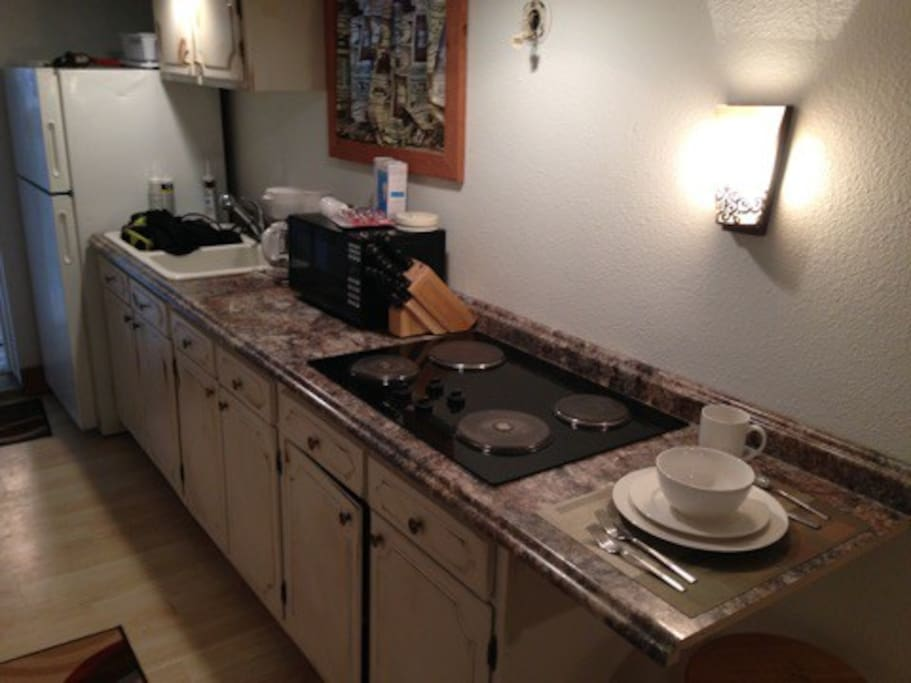 Galley kitchen fully furnished.