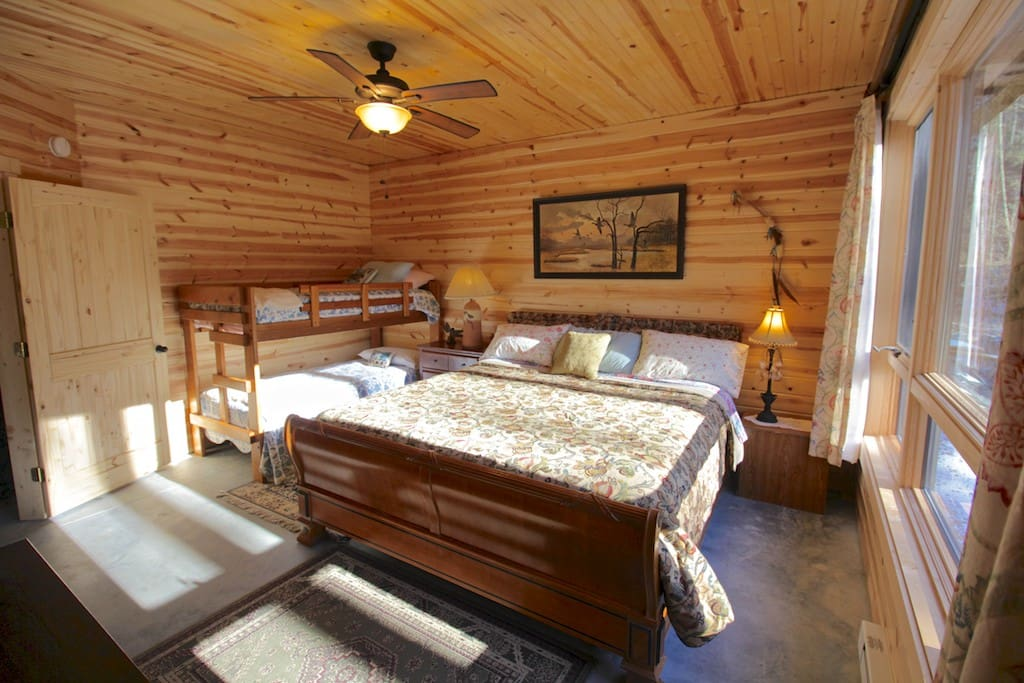 A King and set of Twin bunk beds in the Master bedroom